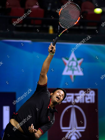 Mahesh Bhupathi Indian tennis player Mahesh Bhupathi serves during an exhibition mixed doubles match against Martina Navratilova and Leander Paes to promote International Premier Tennis League (IPTL) in New Delhi, India