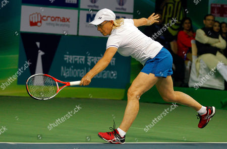 Martina Navratilova Tennis legend Martina Navratilova plays a shot during an exhibition mixed doubles match against Sania Mirza and Mahesh Bhupathi to promote International Premier Tennis League (IPTL) in New Delhi, India
