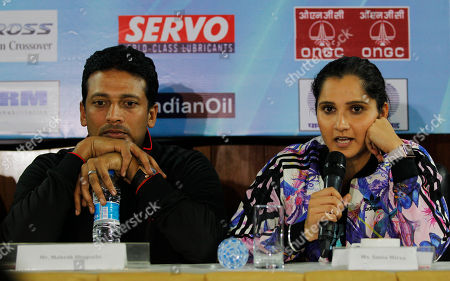 Sania Mirza, Mahesh Bhupathi Indian tennis player Sania Mirza, right, speaks with Mahesh Bhupathi seated beside her during a press conference ahead of the International Premier Tennis League (IPTL) in New Delhi, India