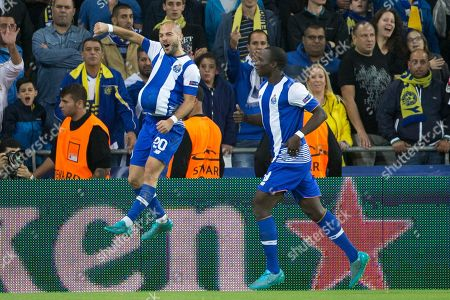 Stock Photo of Andre Andre, Vincent Aboubakar Porto's Andre Andre, left, celebrates his goal with Porto's Vincent Aboubakar against Maccabi Tel Aviv during group G Champions League soccer match in Haifa, Israel