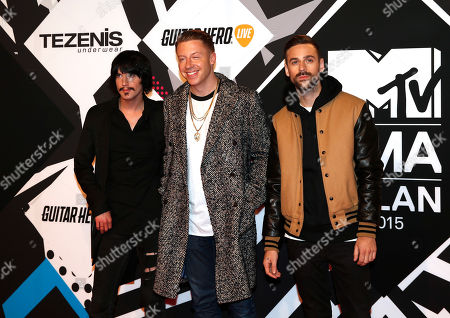 Eric Nally, left, Macklemore and Ryan Lewis arrive for the 2015 MTV European Music Awards in Milan, Italy