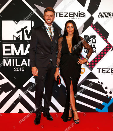 Kyle Christie, left, and Marnie Simpson arrive for the 2015 MTV European Music Awards in Milan, Italy