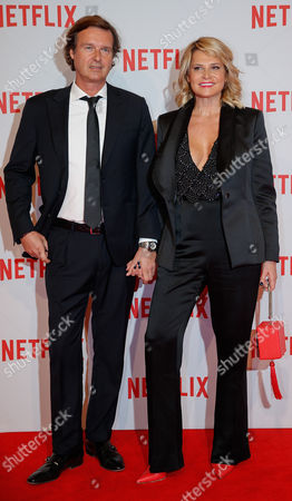 Stock Picture of TV host Simona Ventura flanked by Gian Gerolamo Carraro attend the presentation of Netflix on-demand internet streaming media provider, in Milan, Italy