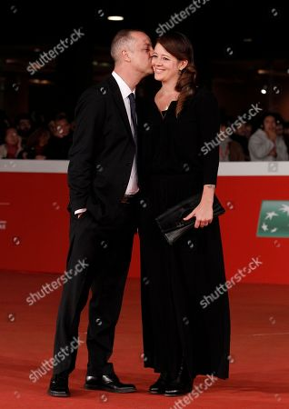 Stock Picture of Claudio Cupellini Chiara Cupellini Director Claudio Cupellini kisses his wife Chiara on the red carpet for the screening of his movie Alaska, at Rome's Film Festival, in Rome
