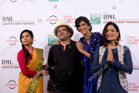 Stock Picture of Rajshri Deshpande, Pan Nalin, Anushka Manchanda, Sandhya Mridul From left, actresses Rajshri Deshpande, director Pan Nalin, and actresses Anushka Manchanda and Sandhya Mridul pose for photographers during the photo call of the movie Angry Indian Goddesses at the Rome Film Festival in Rome