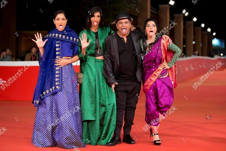 From left, actresses Sandhya Mridul, Anushka Manchanda, director Pan Nalin and actress Rajshri Deshpande arrive for the screening of the movie Angry Indian Goddesses, at Rome's Film Festival, in Rome