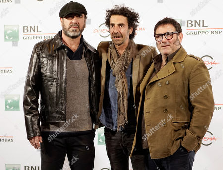 Stock Image of Sergi Lopez Eric Cantona Sergi lopez From left, actor Enric Cantona, director Laurent Laffargue and actor Sergi Lopez pose for photographers during the photo call of the movie Les Rois du Monde/Mad Kings, at Rome's Film Festival, in Rome