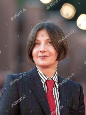 Author Donna Tartt poses for photographers as she arrives for on the red carpet of the Rome's Film Festival in Rome