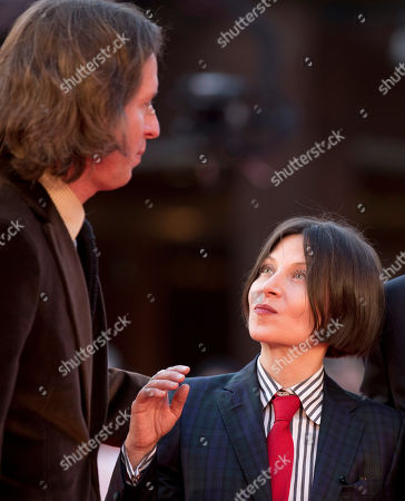 Director Wes Anderson, left, and author Donna Tartt pose for photographers as they arrive on the red carpet of the Rome's Film Festival in Rome