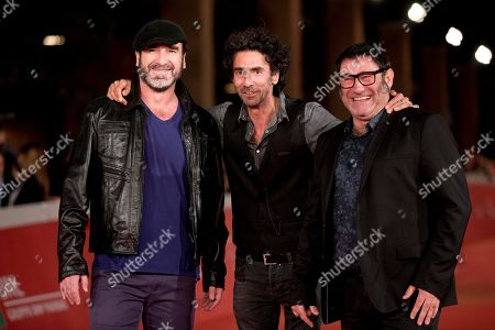 Stock Photo of Enric Cantona, Laurent Laffargue, Sergi Lopez From left, actor Enric Cantona, director Laurent Laffargue and actor Sergi Lopez pose for photographers as they arrive on the red carpet of the Rome's Film Festival in Rome