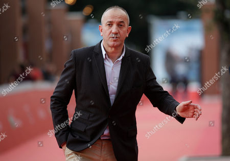 Stock Photo of Philippe Claudel Director Philippe Claudel poses for photographers as he arrives for the screening of the movie Une Enfance at Rome's Film Festival in Rome