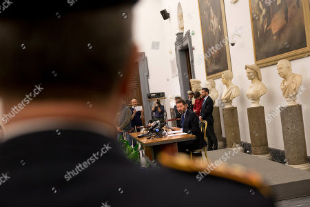 Ignazio Marino, center, meets the media at Rome's Campidoglio Capitol Hill, . Just a day after rescinding his resignation, Rome's embattled mayor has acknowledged the end of his administration after the city council yanked its support