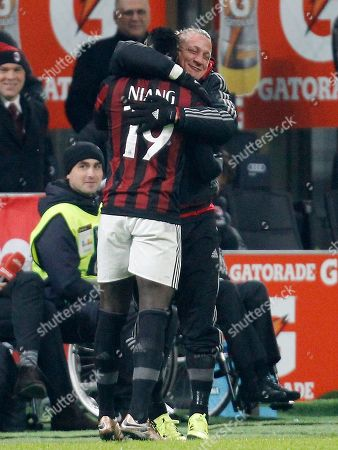 Stock Picture of AC Milan's Mbaye Niang, left, celebrates with his teammate Philippe Mexes after scoring during the Serie A soccer match between AC Milan and Sampdoria at the San Siro stadium in Milan, Italy, Saturday, Nov. 28, 2015