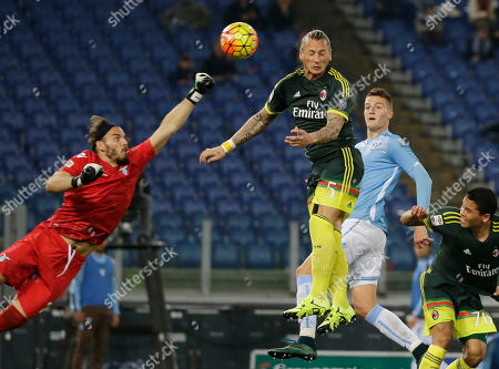 AC Milan's Philippe Mexes, third from right, scores past Lazio goalkeeper Federico Marchetti, left, during a Serie A soccer match between Lazio and Milan, at Rome's Olympic Stadium