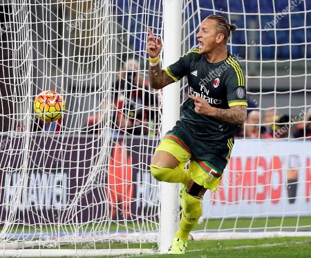 AC Milan's Philippe Mexes celebrates after scoring during a Serie A soccer match between Lazio and Milan, at Rome's Olympic Stadium