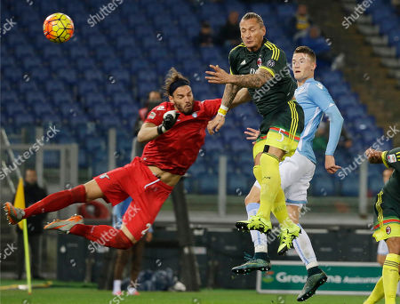 AC Milan's Philippe Mexes, second from right, scores past Lazio goalkeeper Federico Marchetti during a Serie A soccer match between Lazio and Milan, at Rome's Olympic Stadium