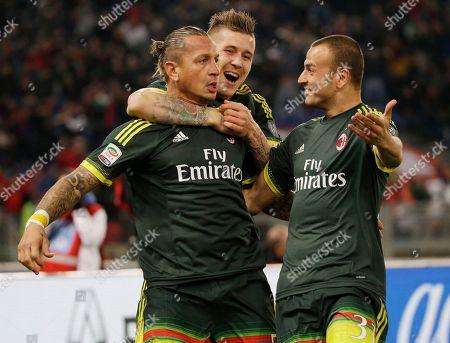 Stock Image of AC Milan's Philippe Mexes, left, celebrates with his teammates Juraj Kucka, center, and Luca Antonelli after he scored during a Serie A soccer match between Lazio and Milan, at Rome's Olympic Stadium