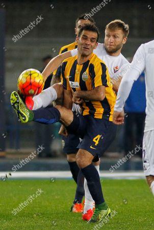 Rafa Marquez, Jakub Blaszczykowski Hellas Verona's Rafa Marquez, foreground, is challenged by Fiorentina's Jakub Blaszczykowski during a Serie A soccer match at Bentegodi stadium in Verona, Italy