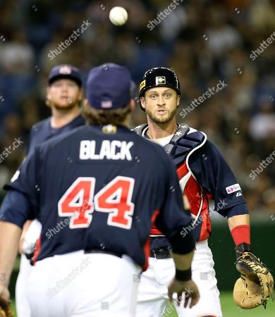 Dan Rohlfing, Dan Black USA's catcher Dan Rohlfing, right, and first baseman Dan Black watch a foul ball hit by South Korea's Hwang Jae-gyun as they cannot catch it during the third inning of their final game at the Premier12 world baseball tournament at Tokyo Dome in Tokyo