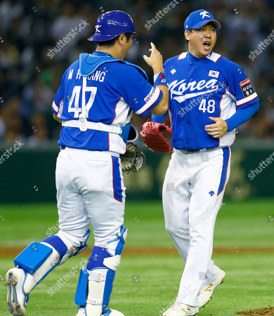 Lee Hyun-seung, Kang Min-ho South Korea's closer Lee Hyun-seung, right, and catcher Kang Min-ho celebrate after beating Japan 4-3 in their semifinal game at the Premier12 world baseball tournament at Tokyo Dome in Tokyo, . South Korea advance to the final