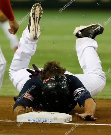Dan Black USA's designated hitter Dan Black slides into third base on Adam Frazier's single against Mexico during the fifth inning of their semifinal game at the Premier12 world baseball tournament at Tokyo Dome in Tokyo