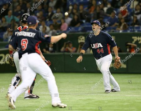 Dan Black, Dan Rohlfing, Tyler Pastornicky USA's first baseman Dan Black (44) and catcher Dan Rohlfing, left back, watch a foul ball as they cannot catch it during the third inning of their final game against South Korea at the Premier12 world baseball tournament at Tokyo Dome in Tokyo, . Watching them is third baseman Tyler Pastornicky