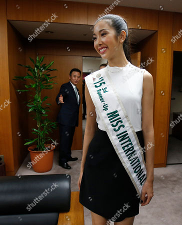 Pham Hong Thuy Van Miss Vietnam Pham Hong Thuy Van enters the room of Yosuke Takagi, back, Japan's state minister of Economy, Trade and Industry, as 2015 Miss International runners-up pay a courtesy call on him in Tokyo