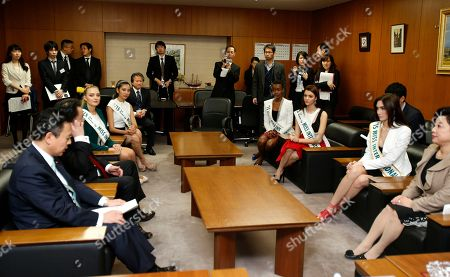 Yosuke Takagi, Eunice Onyango, Jennifer Valle, Edymar Martinez, Pham Hong Thuy Van, Lindsay Becker,Akimi Shimomura 2015 Miss International runners-up take seats to meet Yosuke Takagi, left, Japan's state minister of Economy, Trade and Industry, during their courtesy call on him in Tokyo, . The runners-up are, from left clockwise, Miss USA Lindsay Becker, Miss Vietnam Pham Hong Thuy Van, Miss Kenya Eunice Onyango, Miss Honduras Jennifer Valle and Miss International Edymar Martinez of Venezuela