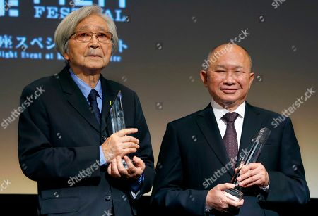 """Stock Picture of John Woo, Yoji Yamada Hong Kong director John Woo, right, and Japanese director Yoji Yamada pose for photographers during the awarding ceremony of Samurai Award at the 28th Tokyo International Film Festival in Tokyo . """"I have to say that I'm very surprised. I never thought that I would receive this award. Even though I have made a lot of films but it hardly qualifies as making a special contribution (to cinema). I'm just a hard working film maker. I'm very thankful to receive this award and also very surprised.,"""" Woo said. The award was launched to honor trailblazers in cinema who have made outstanding contributions to the art of movie making"""
