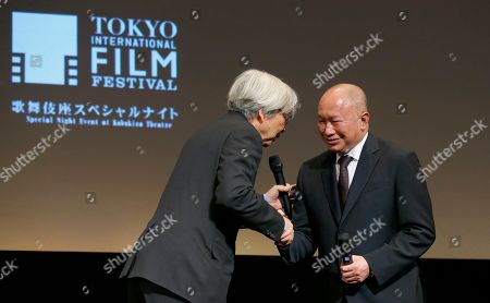 """John Woo, Yoji Yamada Samurai Award recipients, Hong Kong director John Woo, right, and Japanese director Yoji Yamada, shake hands during the awarding ceremony of Samurai Award at the 28th Tokyo International Film Festival in Tokyo . """"I have to say that I'm very surprised. I never thought that I would receive this award. Even though I have made a lot of films but it hardly qualifies as making a special contribution (to cinema). I'm just a hard working film maker. I'm very thankful to receive this award and also very surprised.,"""" Woo said. The award was launched to honor trailblazers in cinema who have made outstanding contributions to the art of movie making"""