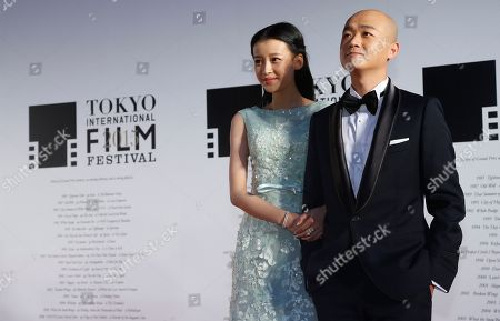 Stock Photo of Sun Li, Bao Beier Chinese actress Sun Li, left, and Chinese actor Bao Beier pose for photos during the opening ceremony of the 28th Tokyo International Film Festival in Tokyo