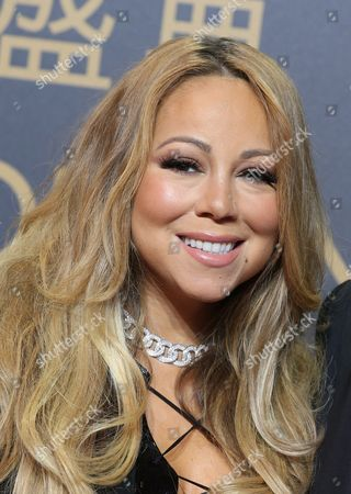"""Mariah Carey Singer Mariah Carey poses on the red carpet of the opening ceremony for the Studio City project in Macau. Macy's announced Monday, Nov. 2, 2015 that Carey, Questlove from the Roots, the cast of """"Sesame Street,"""" Pat Benatar and Neil Giraldo will be among the stars celebrating at Macy's Thanksgiving Day Parade on Nov. 26, 2015"""