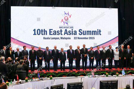 Ban Ki-moon, Benigno Aquino III, Thein Sein, Shinzo Abe, Joko Widodo, Narendra Modi, Hun Sen, Malcolm Turnbull, Thongsing Thammavong, Li Keqiang, Najib Razak, Barack Obama, Hassanal Bolkiah, Nguyen Tan Dung, Dmitry Medvedev, Prayuth Chan-ocha, Park Geun-hye, Lee Hsien Loong, John Key Leaders from left to right, U.N. Secretary General Ban Ki-moon, Philippines President Benigno Aquino III, Myanmar's President Thein Sein, Japanese Prime Minister Shinzo Abe, Indonesian President Joko Widodo, Indian Prime Minister Narendra Modi, Cambodia's Prime Minister Hun Sen, Australian Prime Minister Malcolm Turnbull, Laos' Prime Minister Thongsing Thammavong, Chinese Premier Li Keqiang, Malaysian Prime Minister Najib Razak, U.S. President Barack Obama, Brunei's Sultan Hassanal Bolkiah, Vietnam's Prime Minister Nguyen Tan Dung, Russian Prime Minister Dmitry Medvedev, Thailand's Prime Minister Prayuth Chan-ocha, South Korean President Park Geun-hye, Singaporean Prime Minister Lee Hsien Loong and New Zealand's Prime Minister John Key pose for photographs during the 10th East Asia Summit at the 27th ASEAN Summit in Kuala Lumpur, Malaysia
