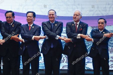 Prayuth Chan-o-cha, Nguyen Tan Dung, John Key, Najib Razak, Thongsing Thammavong Leaders from left to right, Thailand's Prime Minister Prayuth Chan-o-cha, Vietnam's Prime Minister Nguyen Tan Dung, New Zealand Prime Minister John Key, Malaysian Prime Minister Najib Razak and Laos' Prime Minister Thongsing Thammavong chain their hands for a group photo during the 40th New Zealand Anniversary Commemorative Summit in Kuala Lumpur, Malaysia