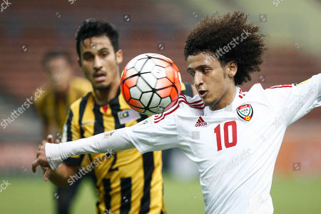 Ahmad Fakri Saarani, Majed Hassan Omar Abdulrahman, right, of the United Arab Emirates vies for possession against Malaysia's Matthew Davies during the Group A World Cup 2018 qualifying soccer match in Shah Alam, Malaysia on