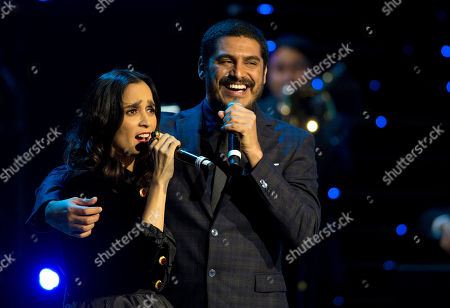 Stock Picture of Julieta Venegas, Criolo Julieta Venegas, left, and Criolo perform together during the Fenix Iberoamerican Film Awards at the Esperanza Iris Theater in Mexico City