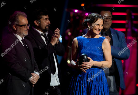 Stock Picture of Antonia Zegers Chilean actress Antonia Zegers, right, holds the award for best film as the cast of El Club or The Club accepts the award at the Fenix Iberoamerican Film Awards at the Esperanza Iris Theater in Mexico City