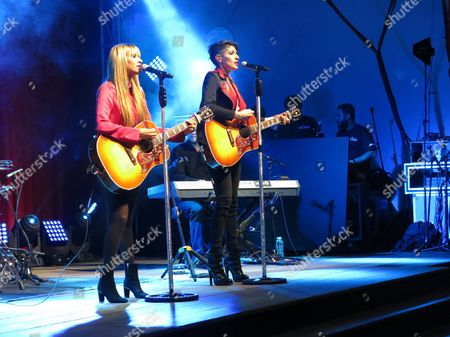 Hanna Nicole Perez Mosa, left, and Ashley Perez Mosa, of the Mexican-American duet Ha*Ash, perform during the Latin Grammy Acoustic Session in Mexico City, late . The acoustic sessions, organized by the Latin Recording Academy, are held in various cities prior to the Latin Grammys, this year set for Nov. 19 in Las Vegas