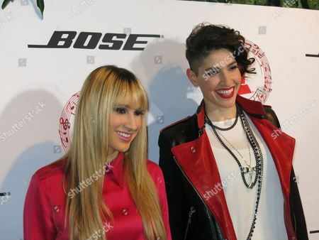Hanna Nicole Perez Mosa, left, and Ashley Perez Mosa, of the Mexican-American duet Ha*Ash, pose for photos at the Latin Grammy Acoustic Session in Mexico City, late . The acoustic sessions, organized by the Latin Recording Academy, are held in various cities prior to the Latin Grammys, this year set for Nov. 19 in Las Vegas