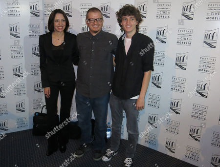 """Stock Photo of Jana Raluy, Sebastian Aguirre, Rodrigo Pla Mexican actors Jana Raluy, left, and Sebastian Aguirre, right, pose for a photo with the Uruguayan-born director Rodrigo Pla, after the presentation of their film, """"Un monstruo de mil cabezas"""" at the 13th edition of Morelia International Film Festival in Morelia, Mexico, . The movie portrays a woman fighting a corrupt insurance system to save her husbandís life"""