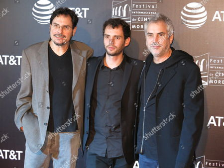 "Jonas Cuaron, Alfonso Cuaron, Carlos Cuaro Mexican director Jonas Cuaron, center, poses on the red carpet of ""Desierto"" with the film's producers, his father Alfonso Cuaron, right, and uncle Carlos Cuaron, at the Morelia International Film Festival, in Morelia, Mexico"