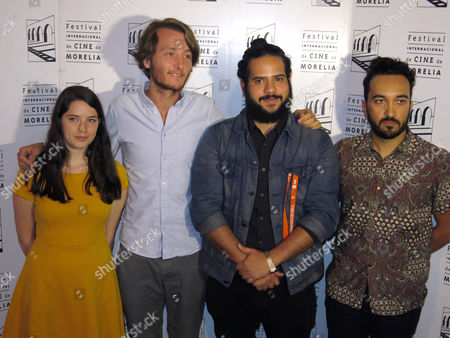 """Members of the film crew of """"Mientras la prision exista"""" pose for a portrait after the presentation of their movie at the Morelia International Film Festival in Morelia, Mexico, . From left are editor Analia Goethals, director Nicolas Gutierrez Wenhmmar, producer Jose Julian Morales Castanon and director assistant Luis Fernando Pacheco"""