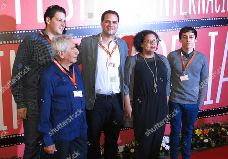 """Cast and crew of the film """"Almacenados"""" pose on the red carpet during the Morelia International Film Festival in Morelia, Mexico, . Shown are producer Yossy Zagha, top left, actor Jose Carlos Ruiz, front left, director Jack Zagha Kababie, center, producer Elsa Reyes, second from right, and actor Hoze Melendez"""