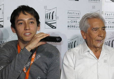 """Actor Hoze Melendez, left, and actor Jose Carlos Ruiz, who star in the film """"Almacenados,"""" give a press conference during the presentation of their film at the Morelia International Film Festival, in Morelia Mexico. Almacenados presents an odd couple of workers at an empty warehouse: an elderly man who is days away from retirement after 39 years at the warehouse and his young replacement, who has been looking for a stable job for two years"""