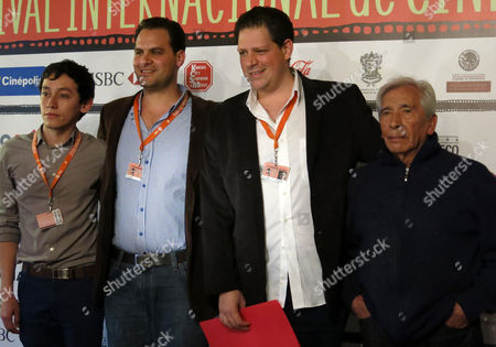 """Actor Hoze Melendez, left, director Jack Zagha Kababie, second from left, Producer Yossy Zagha, second from right and actor Jose Carlos Ruiz of """"Almacenados"""" pose with the Public Award at Morelia International Film Festival on Sat., in Morelia Mexico"""