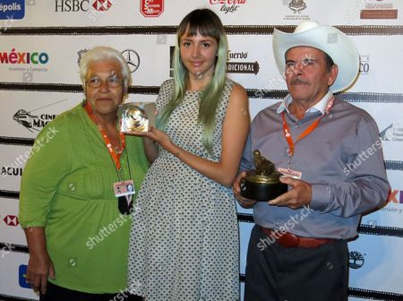 """Stock Image of Betzabe Garcia, center, poses with the award to the Best Documentary for """"Los reyes del pueblo que no existe"""" at Morelia International Film Festival in Morelia, México, on Sat., . At right Jaime Osuna poses with the award to the Best Documentary Directed by a Woman awarded to Garcia for the same film, at left is Yoya Zazueta"""