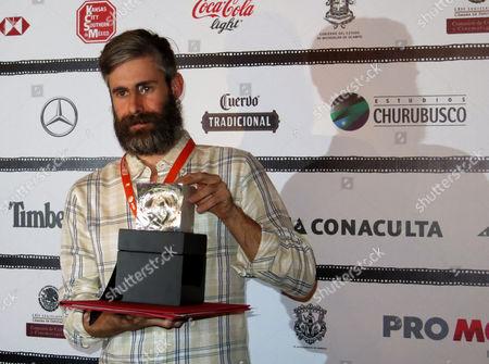 "Stock Photo of Esteban Arrangoiz poses with the award to the Best Documentary Short Film for ""El buzo"" at Morelia International Film Festival in Morelia, México, on Sat"