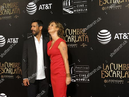Ose Maria Yazpik, Johanna Murillo Mexican actors Jose Maria Yazpik, left, and Johanna Murillo pose for photographers on the red carpet as they arrive for the inauguration of the 13th edition Morelia International Film Festival, in Morelia, Mexico