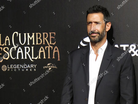 Jose Maria Yazpik, Johanna Murillo Mexican actor Jose Maria Yazpik poses for photographers on the red carpet as he arrives for the inauguration of the 13th edition Morelia International Film Festival, in Morelia, Mexico