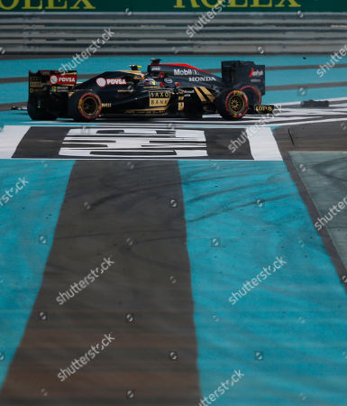 McLaren driver Fernando Alonso of Spain, right, crashes with Lotus driver Pastor Maldonado of Venezuela during the Emirates Formula One Grand Prix at the Yas Marina racetrack in Abu Dhabi, United Arab Emirates